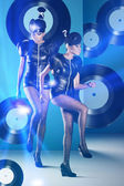 Disco african women dancing with vinyl records around and neon l — Stockfoto