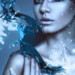 Close up portrait of winter woman with blue splash — Stock Photo #24848845