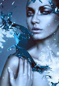Close up portrait of winter woman with blue splash — Stockfoto
