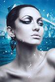 Portrait of brunette winter woman with diamond earring — Stock Photo