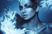 Portrait of winter woman with snow splash — Stock Photo