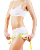 Healthy attractive body with tapemeasure — Stock Photo