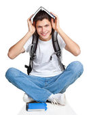 Student textbook satchel sitting — Stock Photo
