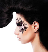 Woman with creative hair and face art with rhinestone — Stock Photo