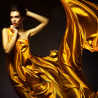 Stock Photo: Attractive woman in yellow fabric