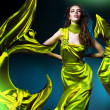 Sensual beautiful woman in green fabric — Stock Photo