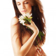 Sensual healthy woman with flower — Stock Photo #35078787