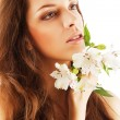 Stock Photo: Pure beautiful womwith flowers