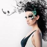 Face art of rhinestones on brunette woman and smoke — Stock Photo #35079013