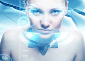 Robot woman with lighting eyes and virtual hologram interfase — Stock Photo