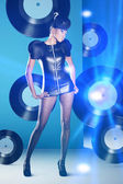 Disco woman with vinyl records and neon light — Stock Photo
