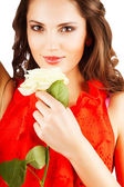Woman in red dress with rose — Stock Photo