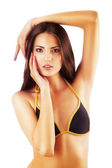 Brunette woman in swimsuit — Stock Photo