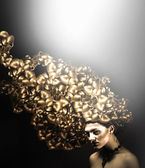 Woman with gold hair — Stock Photo