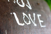 Love text on bench — Stock Photo