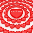 3d hearts around one big heart — Stock Photo