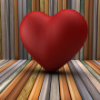 3d red heart shape in wooden room — Stock Photo