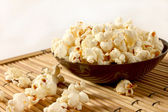 Popcorn over filled in bowl — Stock Photo
