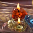 Three candles floating on water bowl — Stock Photo #45452945