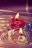 Floating burning candles — Stok fotoğraf
