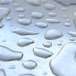 A macro photo of water drops on metal background — Stock Photo