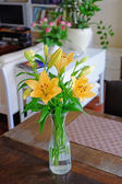 A photo of a Bouquet of beautiful flowers in a vase indoor — Stock Photo
