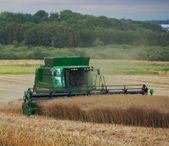 A photo of a harvester and countryside — Stock Photo