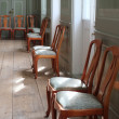 A photo of a chairs in an old historical house - Stock Photo