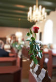 A photo of a red rose - wedding in a Danish Church — Stock Photo