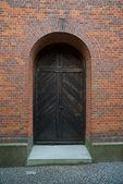 A night photo of Danish church door, church over 500 years old — Stock Photo
