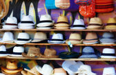 An image blurred photo of lots of hats for sale — Stock Photo