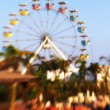 A lens blurred photo of A colourful ferris wheel — Stock Photo #19771723