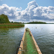 A photo of Jetty on a lake - Stock Photo