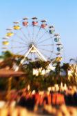 A lens blurred photo of A colourful ferris wheel — Stock Photo