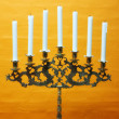 A photo of Hanukkah menorah with candles - Stock Photo