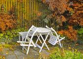 A photo of Garden furniture in autumn — Stock Photo