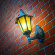 Stock Photo: Photo of outdoor lamp on brick wall