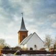 A photo of a Danish church in wintertime - Stock Photo