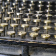A photo close-up photo of an old and dusty typewriter - from 1917 - Photo