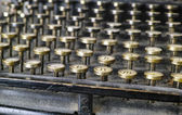 A photo close-up photo of an old and dusty typewriter - from 1917 — Stock Photo