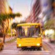 A lens blurred photo of a city bus - Stock Photo