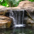 A photo of a small waterfall - Stock Photo