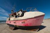 A photo of Fishing boat on the beach, Jutland, Denmark — Stock Photo