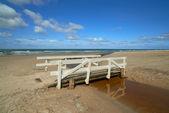 A photo of a Small river bridge at the beach, Jutland, Denmark — Stock Photo