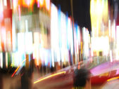 A photo of motion blurred city life — Stock Photo