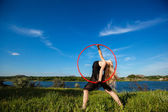 Young beautiful gymnast with hoop — Stock Photo