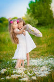 Adorable girls having fun with pillows outdoor — Stock Photo