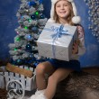 Merry Christmas - cute girl with Christmas gift — Stock Photo