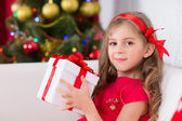 Portrait of little happy cute girl with Christmas present — Stock Photo