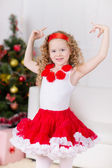Christmas portrait of beautiful curly girl — Stok fotoğraf